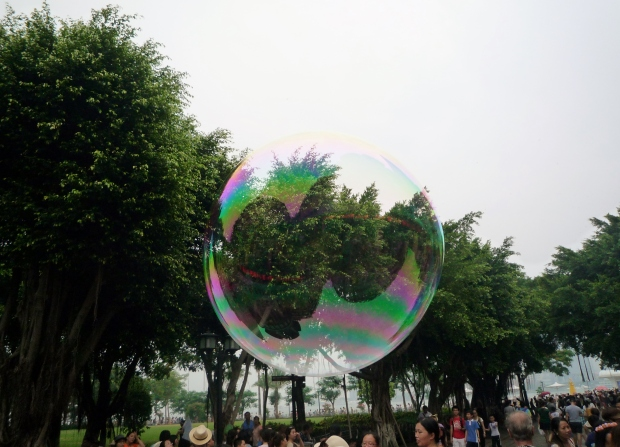 Me lying in the bubble and watching seriously, confused.