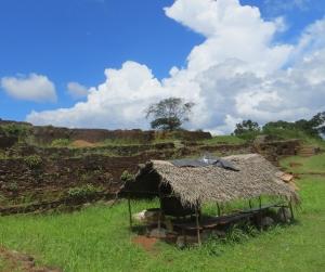 A hut stood under the blue sky alone.